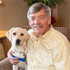 John McKinney with yellow puppy