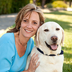 Jeanine Konopelski smiling with yellow lab