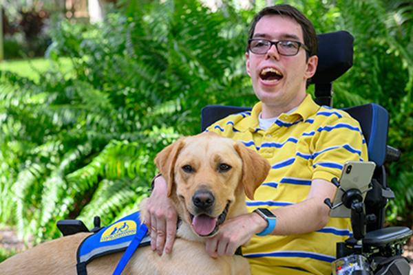 boy in wheelchair with service dog