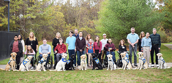 group of students with Canine Companions service dogs