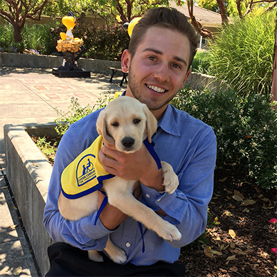Kyle Weatherman holding puppy