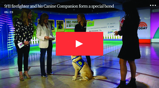 Today Show hosts and Canine Companions instructor with yellow dog with red play button overlaid