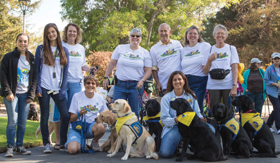 group of Canine Companions volunteers with dogs