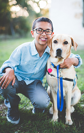 boy with canine companions service dog