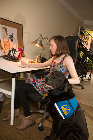 woman drawing with canine companions dog