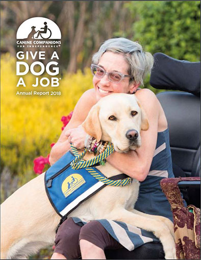 woman sitting in wheelchair with yellow Canine Companions service dog in her lap