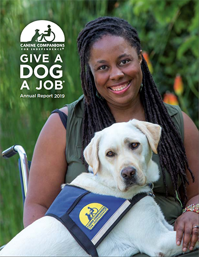 Woman sitting with a Canine Companions service dog