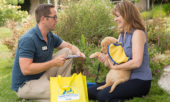 Puppy raiser receives puppy and puppy package
