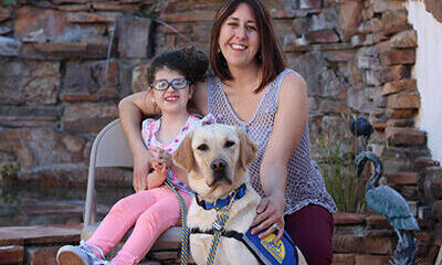 child and adult with Canine Companions service dog