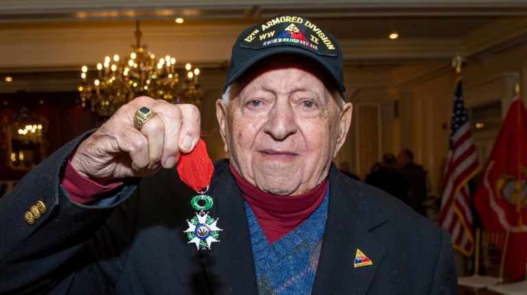 Military veteran holding a medal