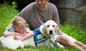 adult and child with Canine Companions service dog