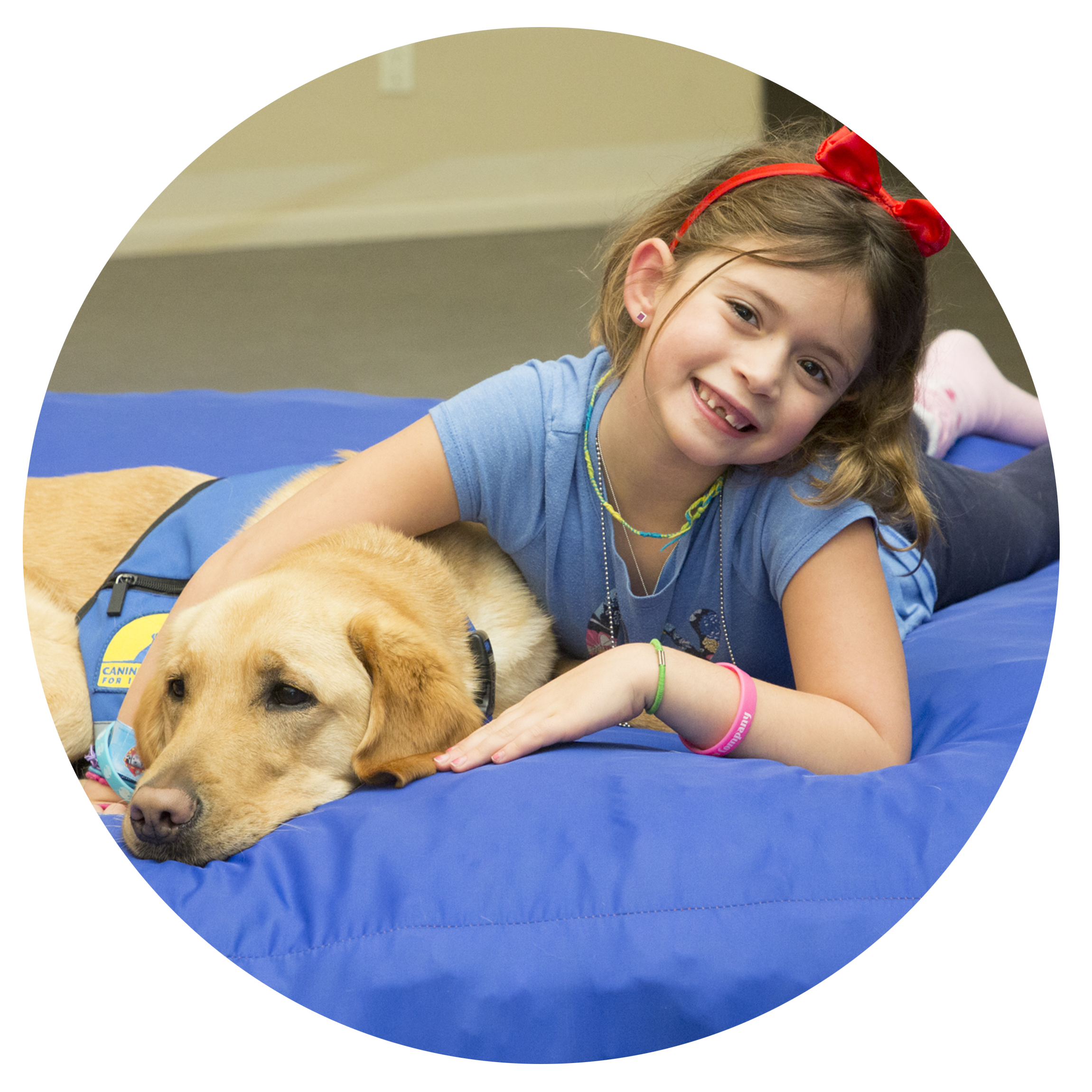 young girl and yellow lab laying down