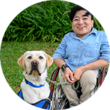 person in wheelchair with dog