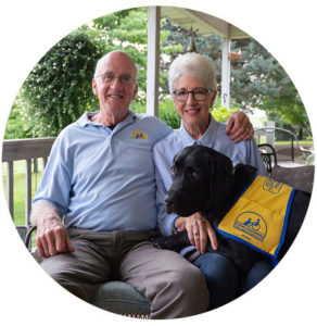 Bob and Connie smiling with dog