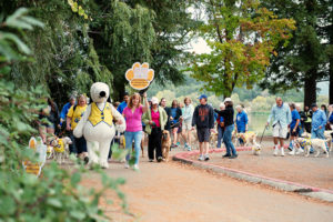 group of people walking with Snoopy