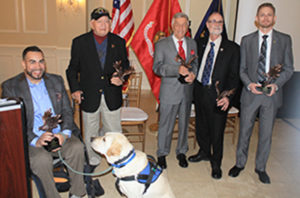 group of people and a Canine Companions service dog