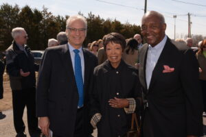 Peter, Joann and John standing together at Grand Opening