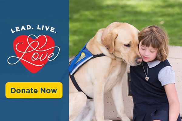 child hugging Canine Companions service dog