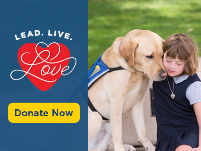 child hugging Canine Companions service dog and text Lead. Live. Love. and a donate button.