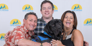 three people with Canine Companions service dog