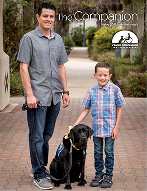 child and adult and Canine Companions service dog