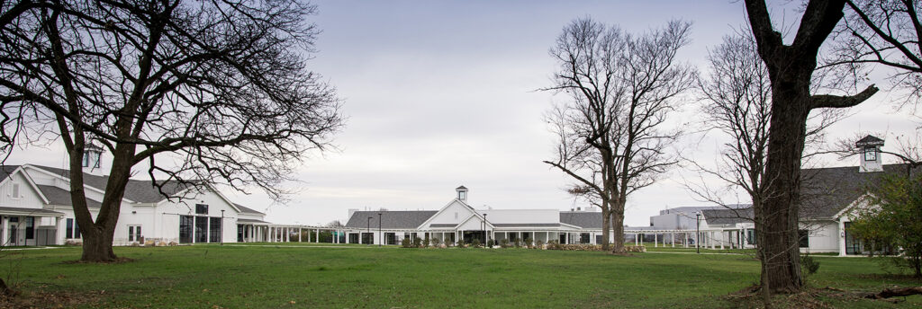 Three North Central buildings in front of a grass field.