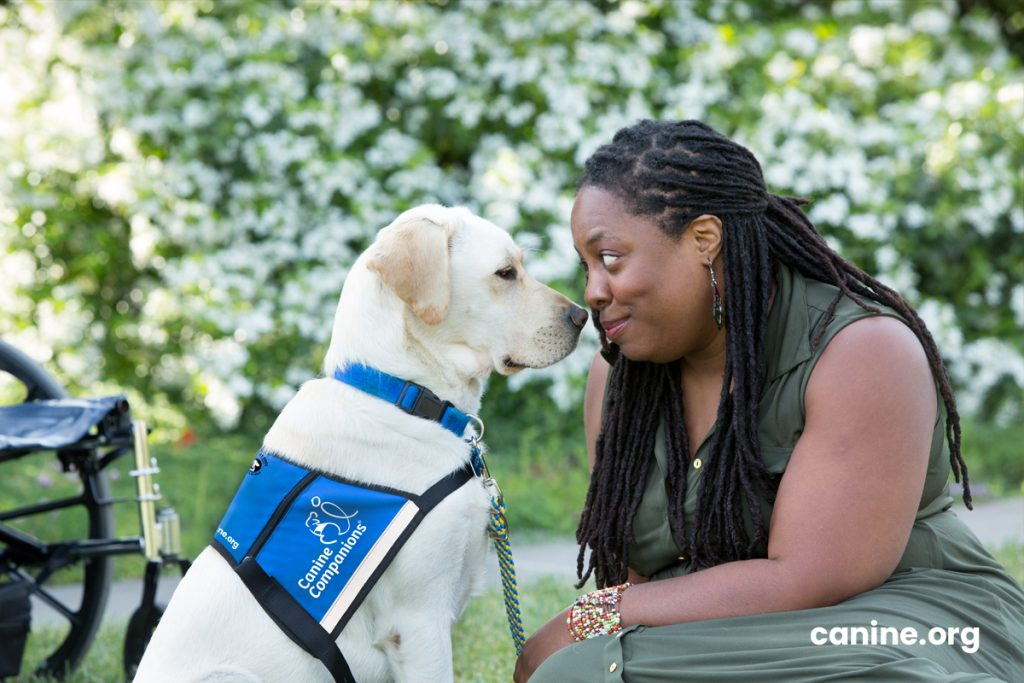 Graduate with her service dog