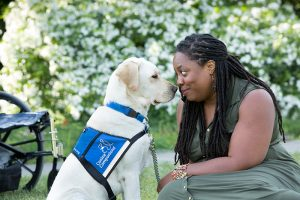 Women nose to nose with her service dog